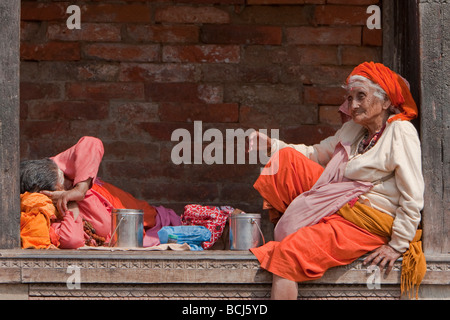 Pashupatinath, Nepal. Female Sadhu, a Hindu Ascetic or Holy Woman, Rests in a Pati, an Open-air Covered Resting - Stock Photo