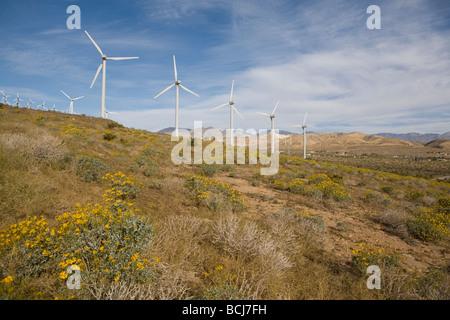 Energy generating windmills in desert against sky Palm Springs California USA Coachella Valey - Stock Photo