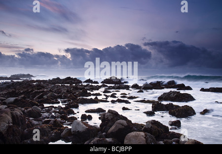 Waves crashing on shore at Asilomar State Beach in the Monterey Peninsula - Stock Photo
