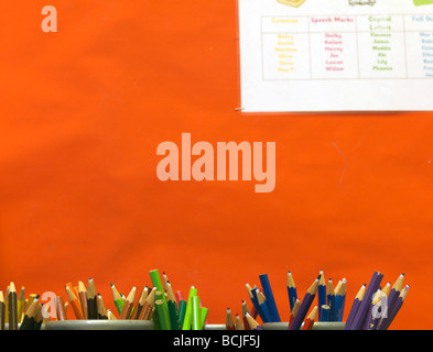 colored pencils in school pots - Stock Photo