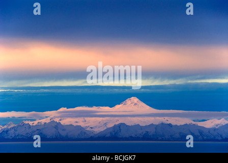 Iliamna Volcano seen across Cook Inlet from the Kenai Peninsula in Southcentral Alaska during Winter - Stock Photo