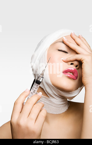 Young woman having cosmetic surgery - Stock Photo