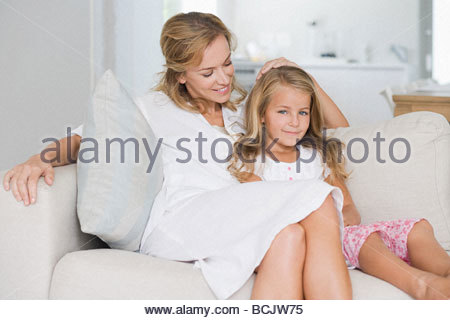 Asian Couple Standing In A Living Room