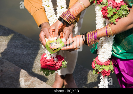 Couple holding puja in indian wedding ceremony