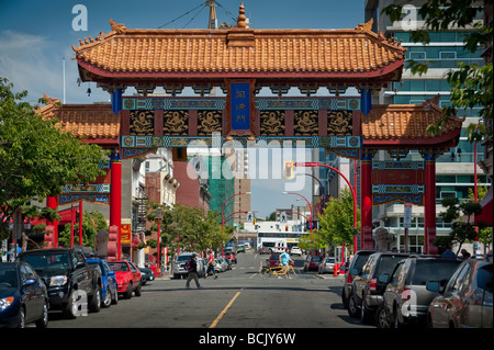 Victoria, British Columbia. The entrance to Chinatown is marked by the beautiful Gate of Harmonious Interest. - Stock Photo