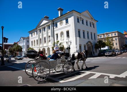 Horse drawn carriage with tourist on site seeing trip through  Historical  Charleston;South Carolina;USA;America - Stock Photo