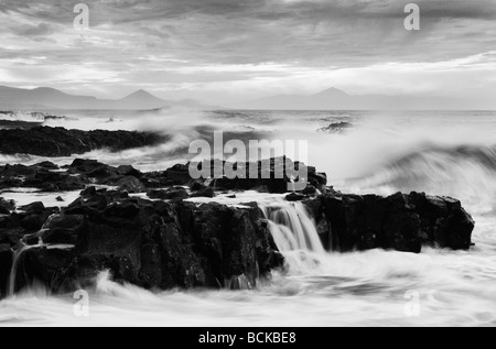 Waves breaking over rocks on north coast of Gran Canaria in The Canary Islands. - Stock Photo