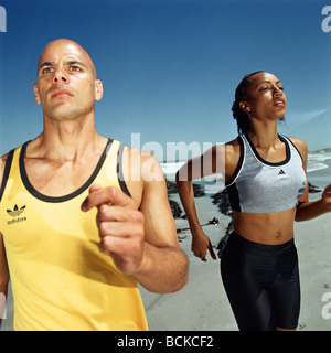 Runners on beach - Stock Photo