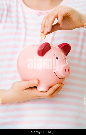 Young girl with piggy bank - Stock Photo
