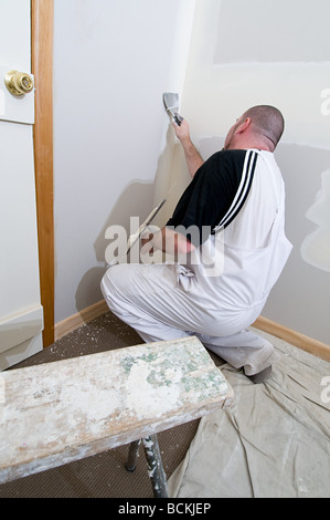 Plasterer working on walls - Stock Photo