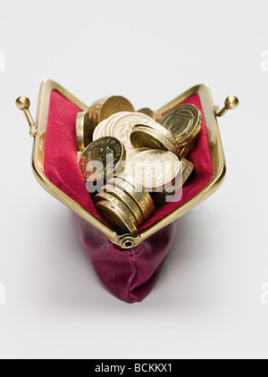 Pound coins in a purse - Stock Photo
