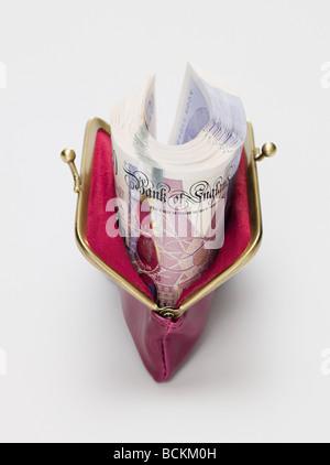 Twenty pound notes in a purse - Stock Photo