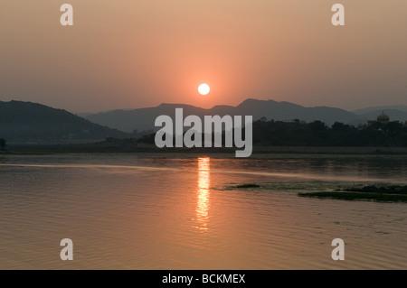 Sunset over lake pichola - Stock Photo