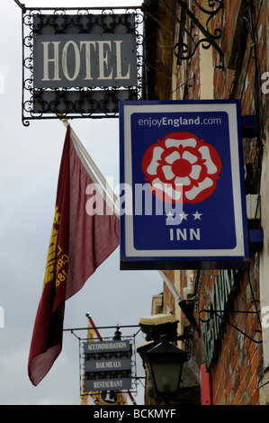 The Enjoy england organisation tudor rose sign on a three star rated inn in Lechlade on Thames England UK - Stock Photo