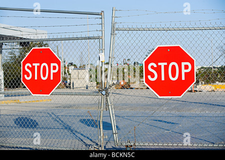Stop signs on gates - Stock Photo
