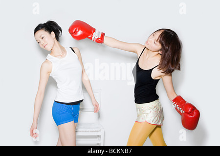 Young women boxing - Stock Photo