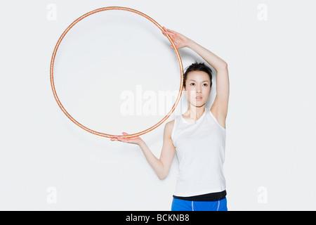 Woman holding hoop