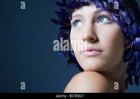 Girl with feather headdress - Stock Photo