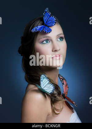 Girl with butterflies - Stock Photo