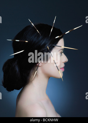 Young woman with porcupine quills in hair - Stock Photo