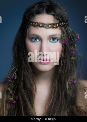 Girl with flowers in hair - Stock Photo