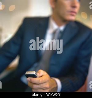 Man holding cellphone - Stock Photo