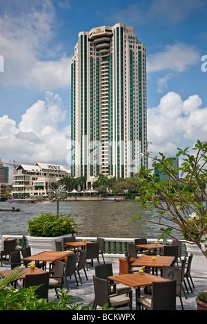 Thailand. The impressive Peninsula Hotel on the banks of the Chao Phraya River where many five-star tourist hotel - Stock Photo