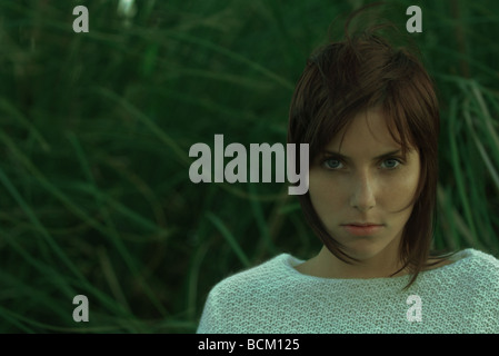 Woman looking at camera, head and shoulders, portrait - Stock Photo