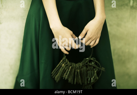 Woman holding keys, close-up of hands - Stock Photo