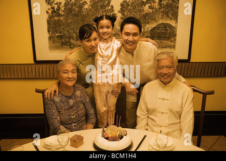 Three generation family during birthday party, smiling at camera, group portrait - Stock Photo