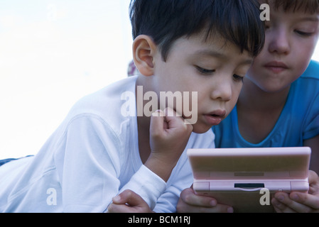 Children playing with video game, close-up - Stock Photo