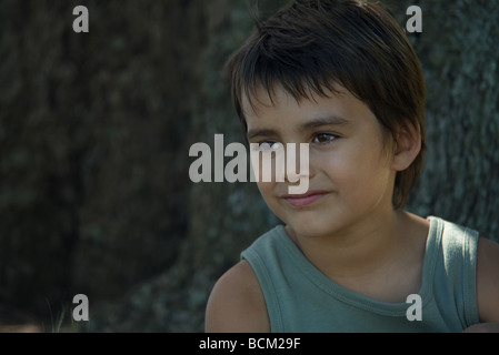 Little boy smiling outdoors, close-up, portrait - Stock Photo
