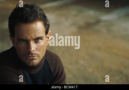 Man staring at camera, portrait - Stock Photo