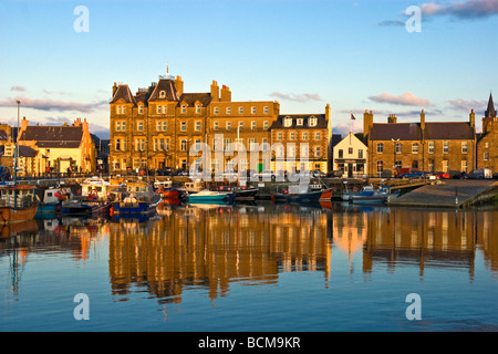Kirkwall harbour on the mainland of Orkney in Scotland with Kirkwall Hotel left of centre. - Stock Photo