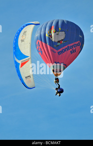Paraglider and balloon 2008 Chateau d Oex Hot Air Balloon Festival Switzerland Europe - Stock Photo