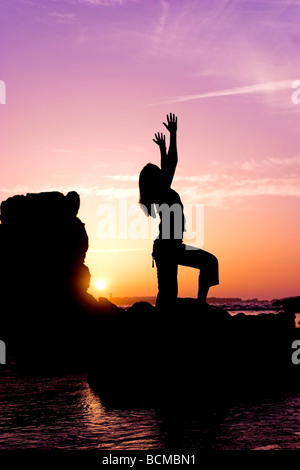 Woman silhouette at the sunset - Stock Photo