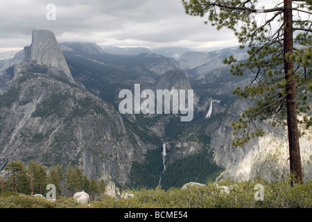 View to Half Dome Pick and Bridal veil waterfalls in Yosemite National Park from Glacier Point - Stock Photo