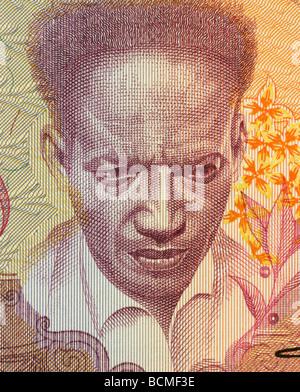 Anton de Kom on 100 Gulden 1988 Banknote from Suriname - Stock Photo