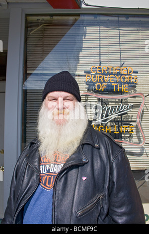 Local man in leather jacket stands outside saloon on Ogden's historic 25th Street. - Stock Photo