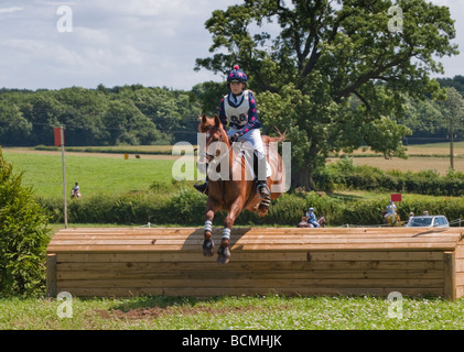 Teenage girl jumping over fence in Pony Club event - Stock Photo