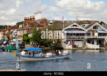 Henley on Thames the Royal Thamesis replica royal barge and crew rowing their passengers down the River Thames England - Stock Photo