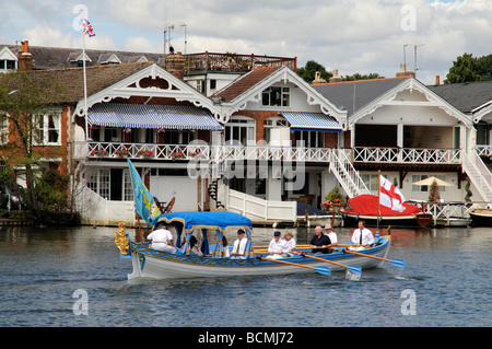Henley on Thames the Royal Thames is replica royal barge and crew rowing their passengers down the River Thames - Stock Photo