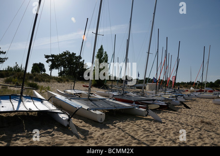 Stock photo of sailboats lined up on the beach for rental The photo was taken on ile d oleron in France - Stock Photo