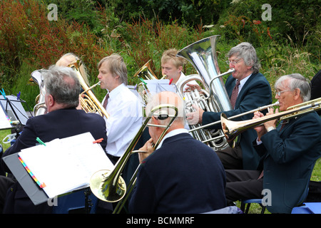 A brass band playing at an English village fete. - Stock Photo