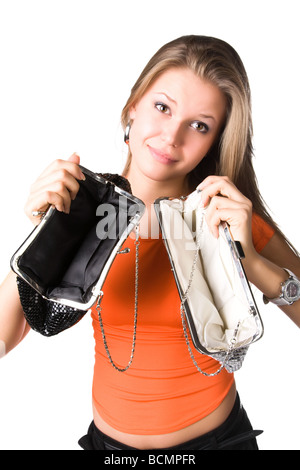 No money in purses Young woman isolated on white - Stock Photo