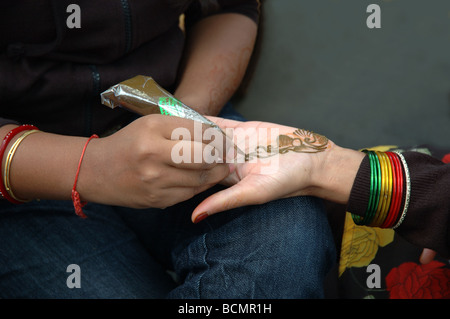 mendi, a pattern of henna, being applied to the palm of an indian woman during the Leicester Mela, Leicester, England, - Stock Photo