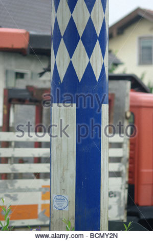 Wooden may pole decorated with blue and white paint in a German village - Bavaria - Stock Photo