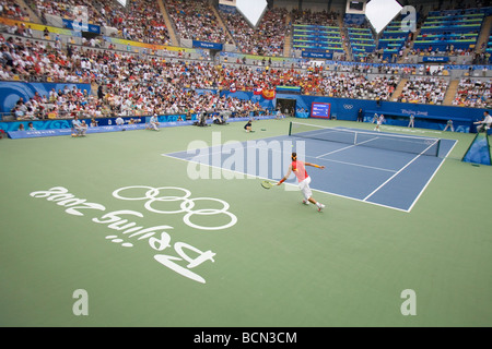 Athlete competing during Good Luck Beijing games in Beijing Olympic Green Tennis Court, Beijing, China - Stock Photo