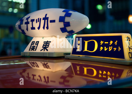 Illuminated taxicab toplight sign in Tokyo Japan - Stock Photo
