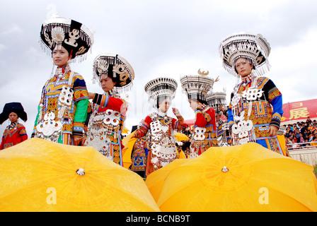 Yi Minority women in elaborate ethnic costume, Torch Festival, Liangshan Yi Autonomous Prefecture, Szechwan Province, - Stock Photo